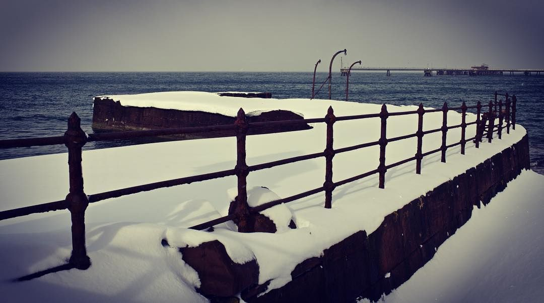 The old pier covered in snow