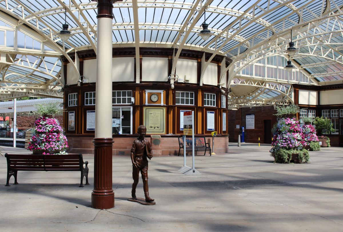 Wemyss Bay Station, showing some of the flowers and the statue that have been provided by the Friends of Wemyss Bay Station